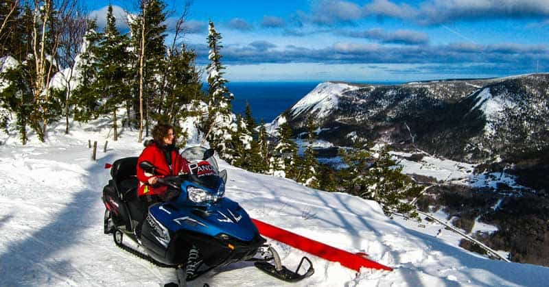 Winter guide - Linda Aksomitis snowmobiling to the top of the Chic-Choc Mountains in the Gaspesie region of Quebec, Canada.