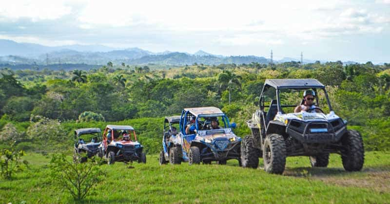 ATVs and side-by-sides driving through pastures.