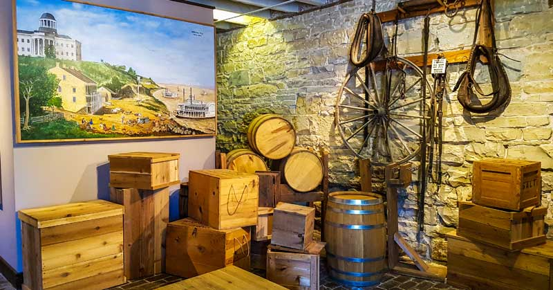 Museum artifacts and painting of Jefferson Landing in the riverboat era on the Missouri River.