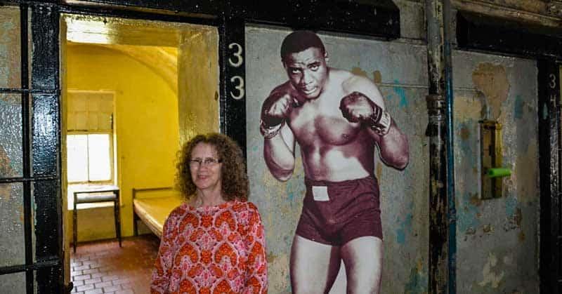 Linda Aksomitis outside Sonny Liston's cell at Missouri State Penitentiary.