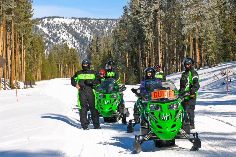 Snowmobiles with a guide in Yellowstone National Park.