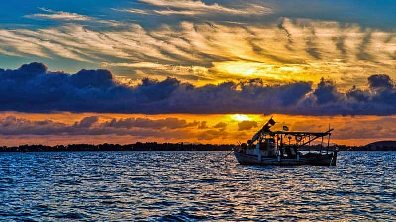 Fishing boat at sunset. Photo provided by author.