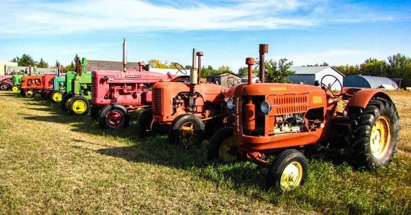 Row of vintage tractors at the Deep South Pioneer Museum in Ogema, Saskatchewan.