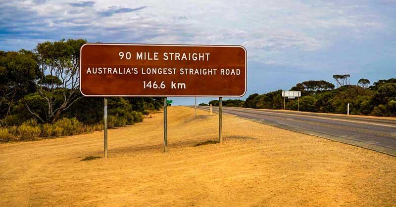 Road sign: 90 mile straight - Australia's longest straight road - 146.6 km.