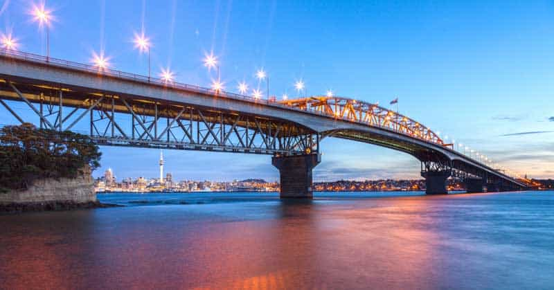 Visit Auckland Harbour Bridge at twilight from Northcote Point in New Zealand. — Photo by TravellingLight
