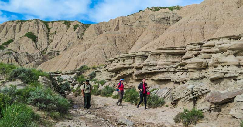 Park ranger with hikers in Toadstool Geologic Park in Nebraska.