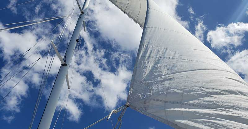 Sails on a catamaran boat in the Dominican Republic.