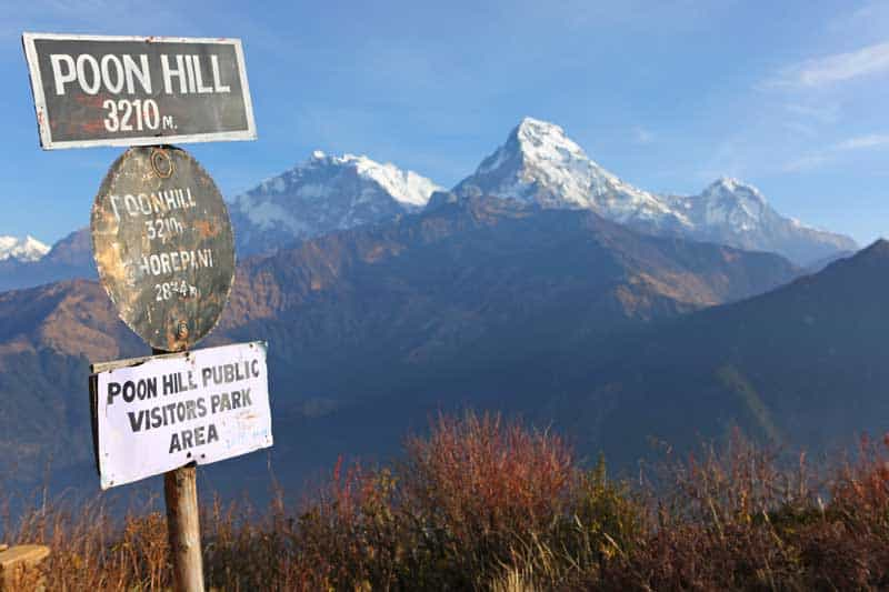 Poon hill altitude sign with Annapurna range in background, Nepal — Photo by phaendin