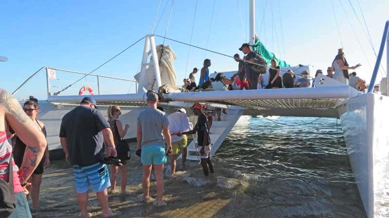 Boarding a catamaran boat in the Dominican Republic.