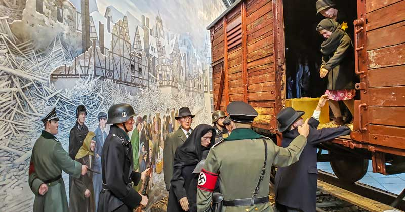 Holocaust mural and railroad car at Fagen Fighters World War II Museum