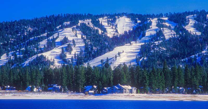 Snow-covered ski slopes form the backdrop for the town of Big Bear, California.