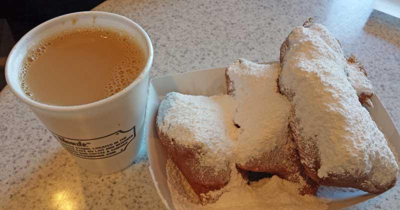 Café au lait and beignets at Café du Monde in New Orleans.