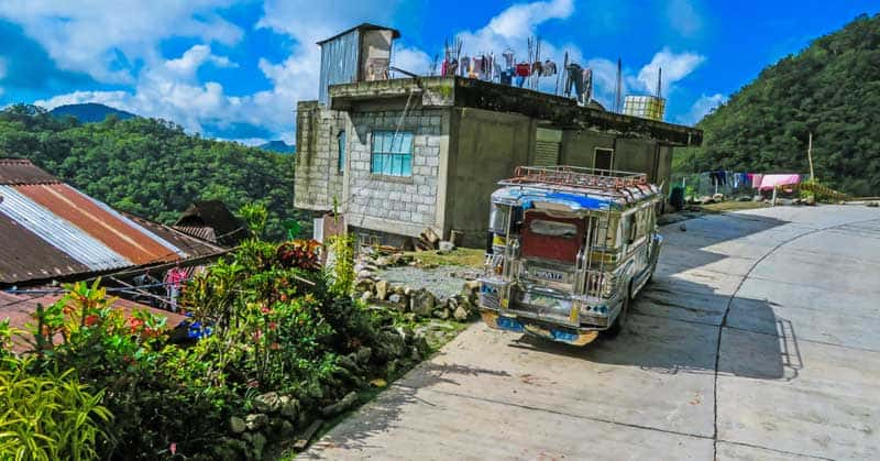 Jeepney parked beside a home in Cordilleras of Philippines.