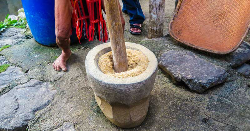 Pounding rice.