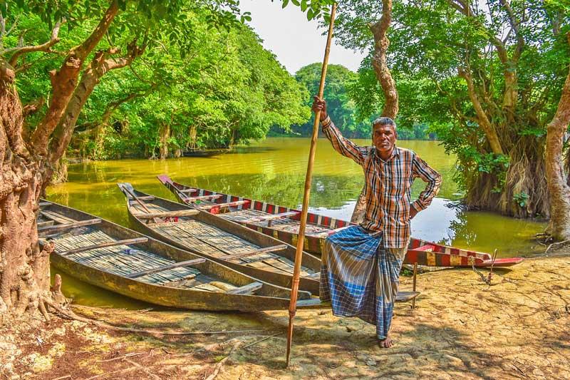 Boat man in Sunderban mangroves.
