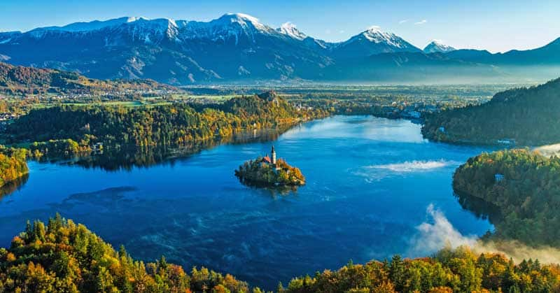 Church on a lake in the mountains in Bled, Slovenia.