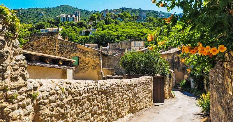Stone walls on a road through an artists' village in France.
